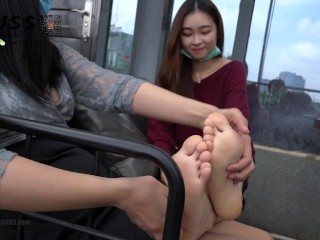 adorable chinese language woman toes tickle