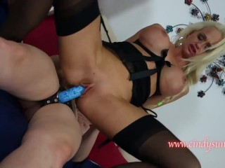 Lily Cade fucks Cindy Solar with a strap-on and makes her squirt along with her fist