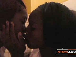 Sexy African Lesbian Sucking Buddy's Pussy Within the Toilet