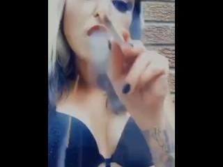 Smoking in a black bra