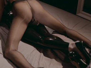 glossy latex catsuit lesbian woman make love together with her black pantyhose lover
