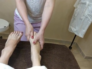 Russian lady getting her toes rubbed
