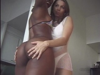 Muscular black girl and white girl in combination