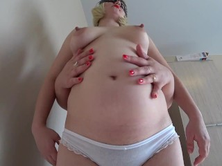 Obese lesbian with strapon fucks pregnant female friend in her bushy pussy.