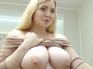 busty blonde pupil lady displays her titties